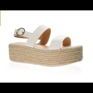 This is a white platform sandals from Go Jane